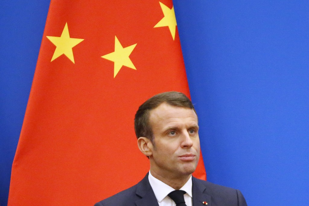 French President Emmanuel Macron looks on as he speaks at a China-France Economic Forum at the Great Hall of the People in Beijing, Wednesday, Nov. 6,...