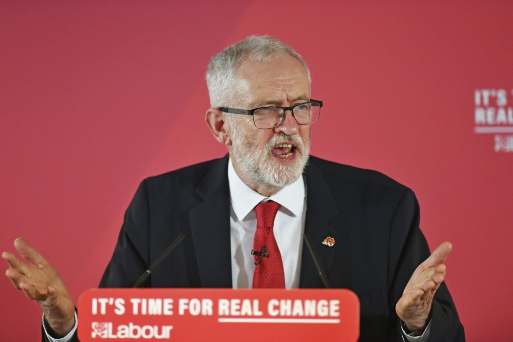 Britain's Labour Party leader Jeremy Corbyn speaks to supporters at the University of Wolverhampton, England, Wednesday Nov. 6, 2019. Britain's three ...