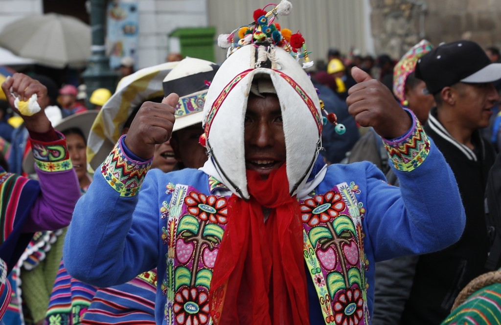 Quechua indigenous supporters of Bolivian President Evo Morales march in defense of his apparent reelection in La Paz, Bolivia, Tuesday, Nov. 5, 2019....