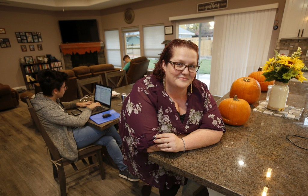 Victoria Sinclaire is seen in her recently rebuilt home with her two exchange students in Paradise, Calif., Tuesday, Nov. 5, 2019. It took Sinclaire s...