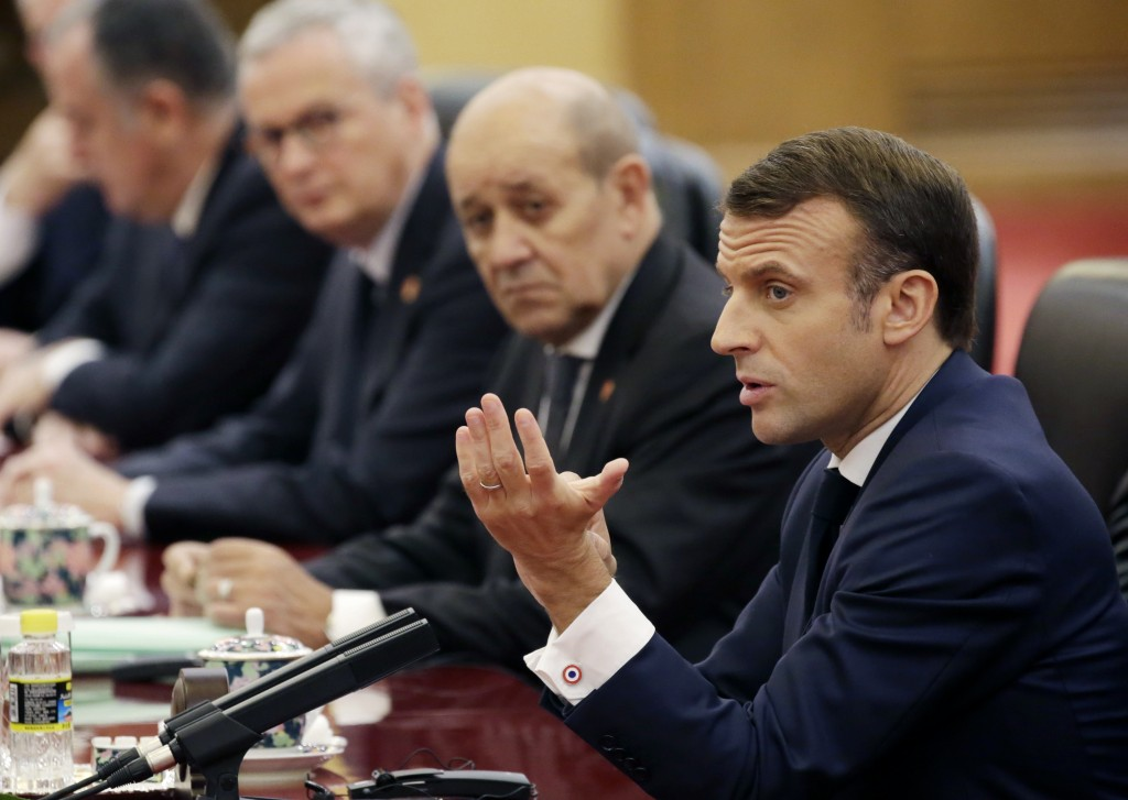 French President Emmanuel Macron attends a meeting with China's President Xi Jinping at the Great Hall of the People in Beijing, China, Wednesday, Nov...