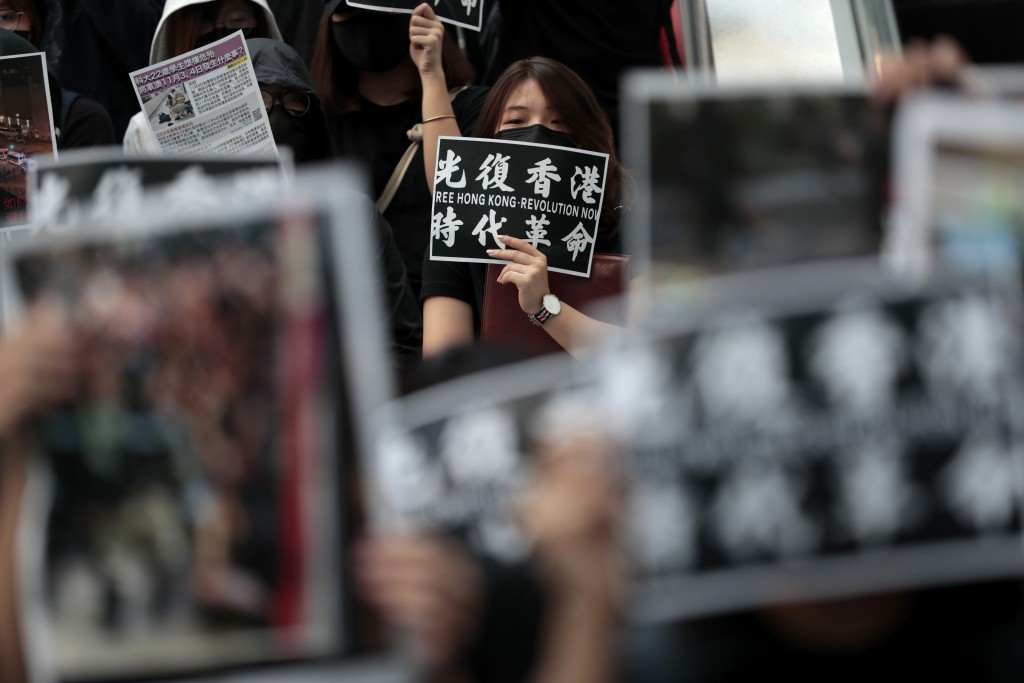 Protesters display posters during an anti-government rally at the Hong Kong University of Science and Technology, Thursday, Nov. 7, 2019, in Hong Kong...