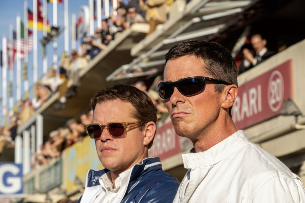 """This image released by 20th Century fox shows Christian Bale, right, and Matt Damon in a scene from """"Ford v. Ferrari,"""" in theaters on Nov. 15. (Merric..."""