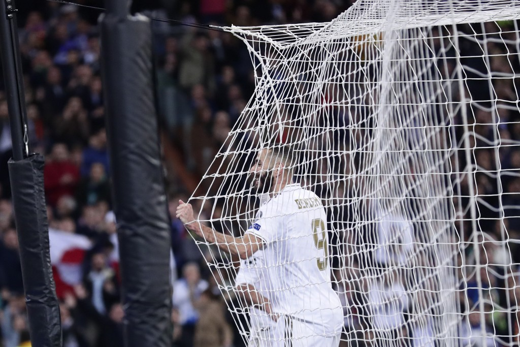 Real Madrid's Karim Benzema celebrates after scoring his side's fifth goal during a Champions League group A soccer match between Real Madrid and Gala...