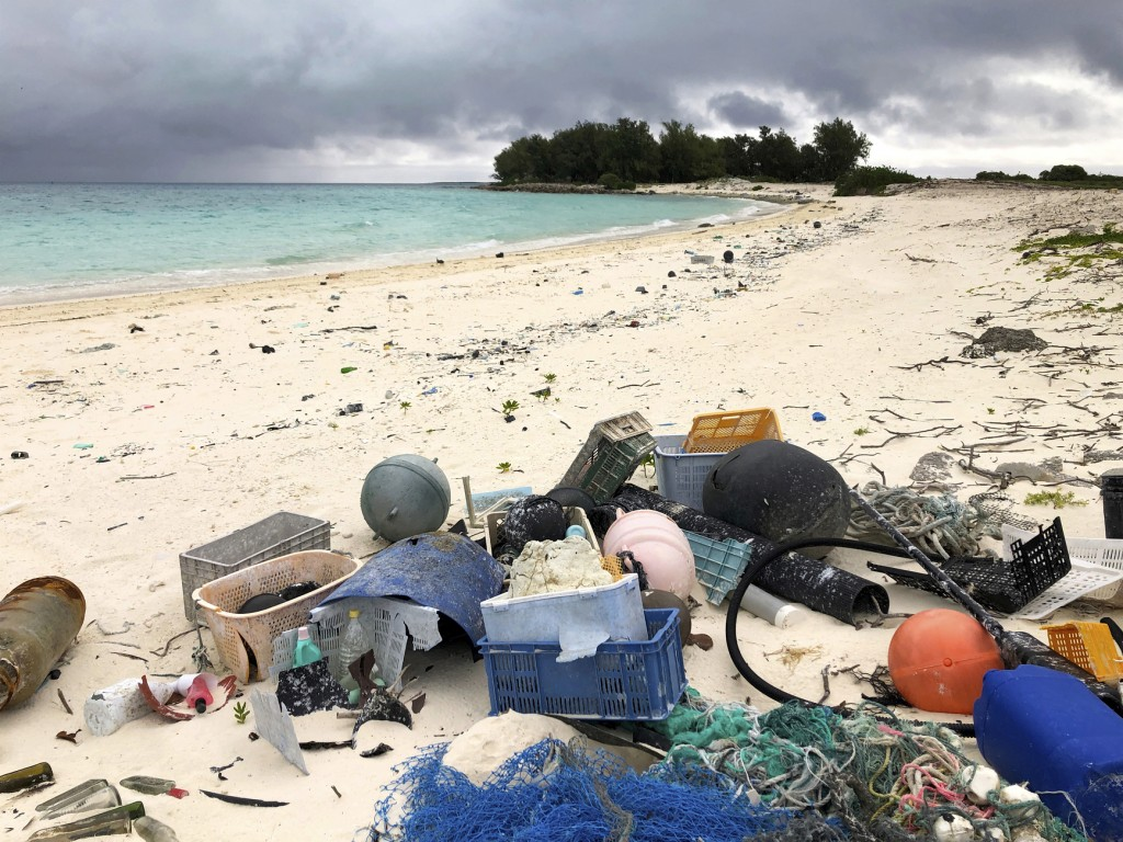 In this Oct. 22, 2019, photo, plastic and other marine debris sits on the beach on Midway Atoll in the Northwestern Hawaiian Islands. In one of the mo...