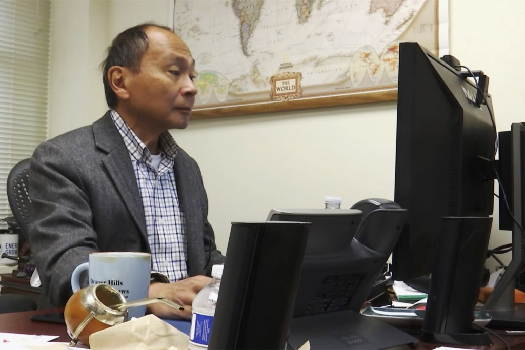 In this Oct. 15, 2019, photo, Berlin Wall political scientist Francis Fukuyama works at his desk at Stanford University in Stanford, Calif. Months bef...