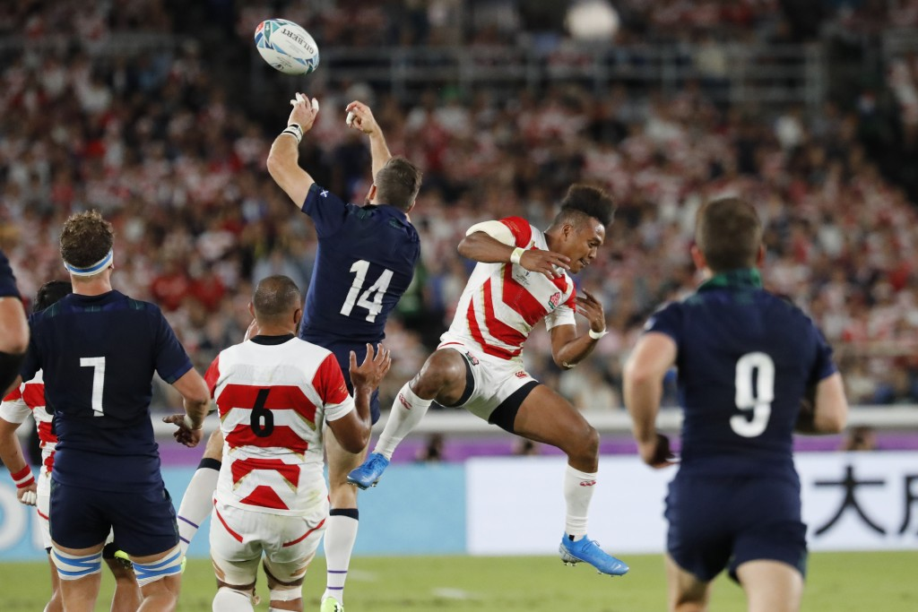 FILE - In this Sunday, Oct. 13, 2019 file photo, Scotland's Tommy Seymour, top left, and Japan's Kotaro Matsushima vie for the ball during the Rugby W...