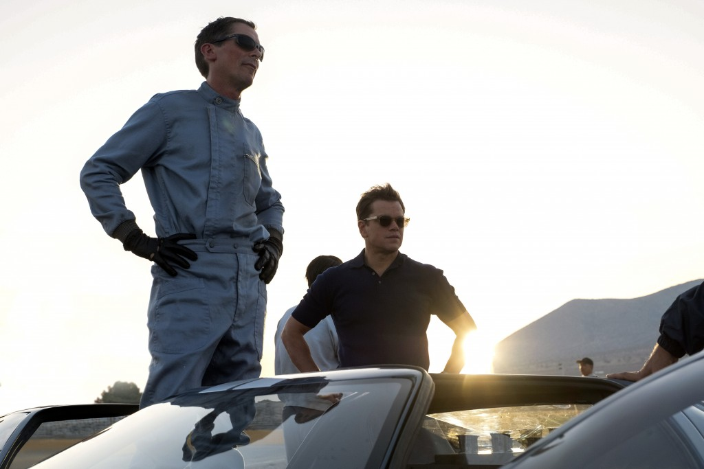 """This image released by 20th Century fox shows Christian Bale, left, and Matt Damon in a scene from """"Ford v. Ferrari,"""" in theaters on Nov. 15. (Merrick..."""