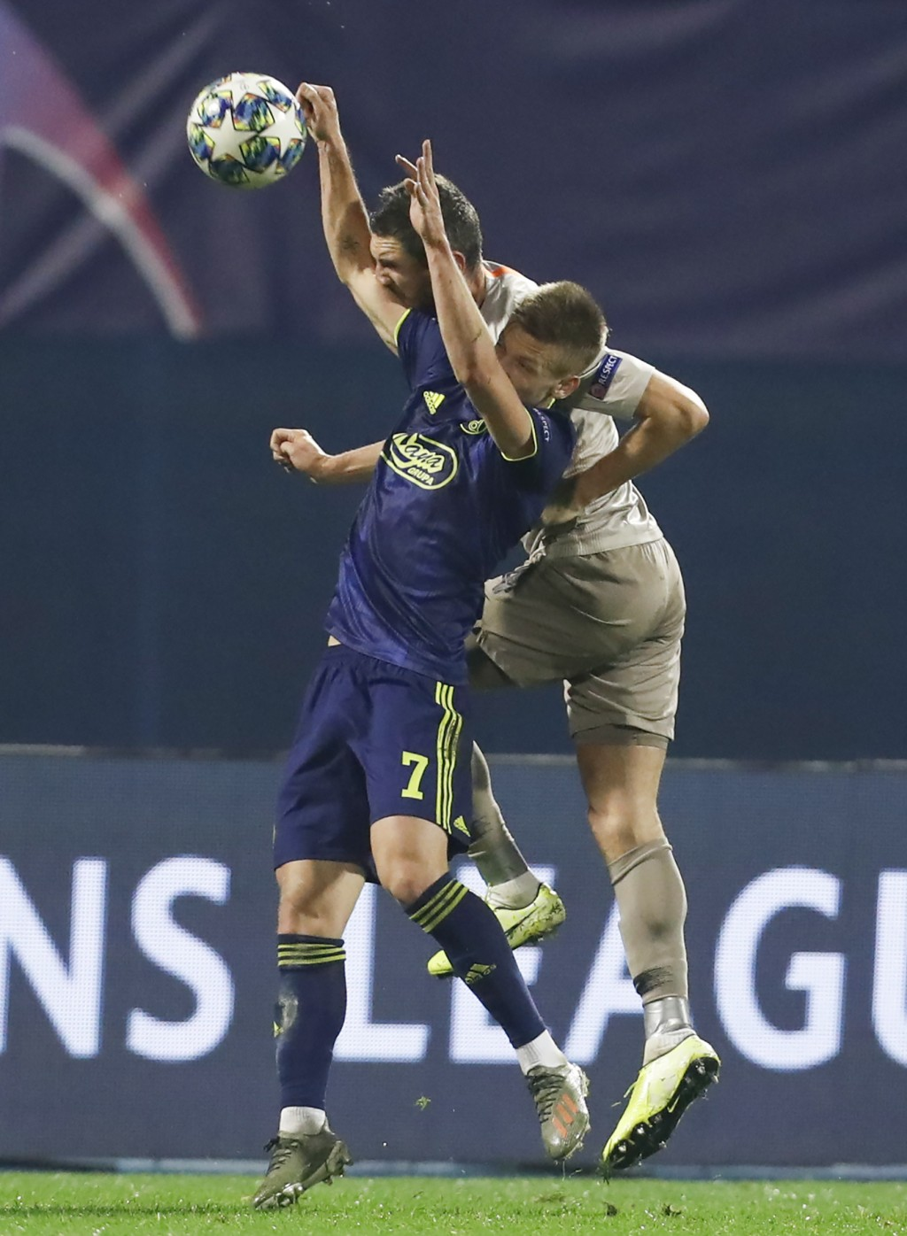 Dinamo Zagreb's Dani Olmo, left, and Shakhtar's Serhiy Kryvtsov head the ball during the group C Champions League soccer match between Dinamo Zagreb a...