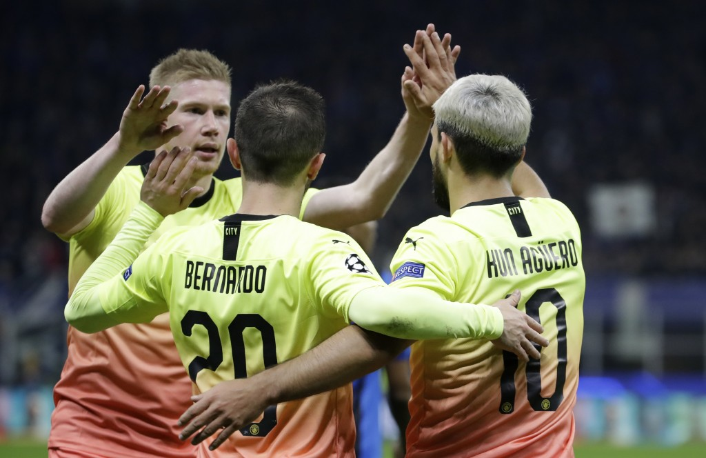 Manchester City's Bernardo Silva, center, celebrates with his teammates Sergio Aguero, right, and Kevin De Bruyne at the end of the Champions League g...
