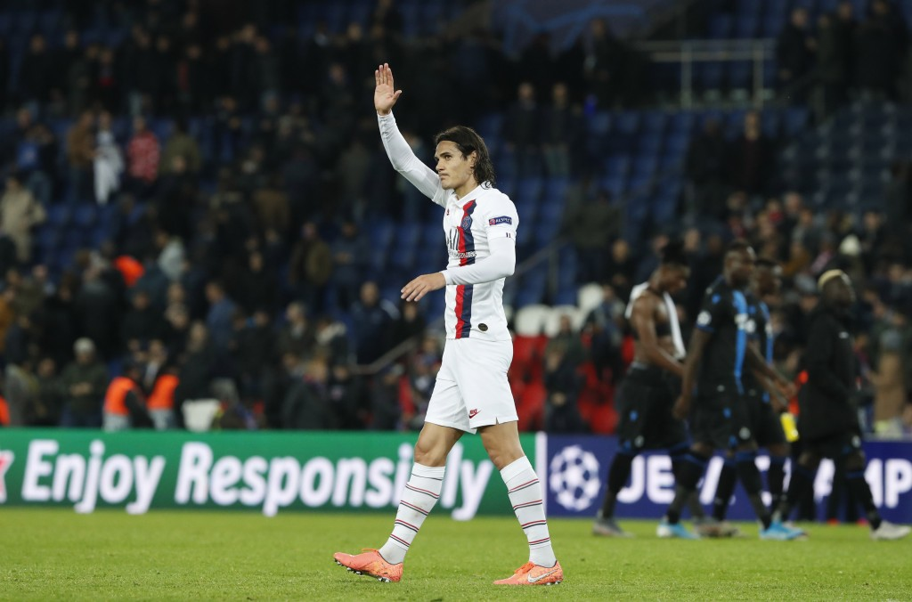 PSG's Edinson Cavani waves his supporters after the end of Champions League group A soccer match between Paris Saint Germain and Club Brugge, at the P...