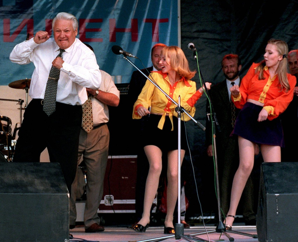 FILE - In this June 10, 1996, file photo, Russian President Boris Yeltsin dances at a rock concert after arriving in Rostov, Russia. (AP Photo/Alexand...