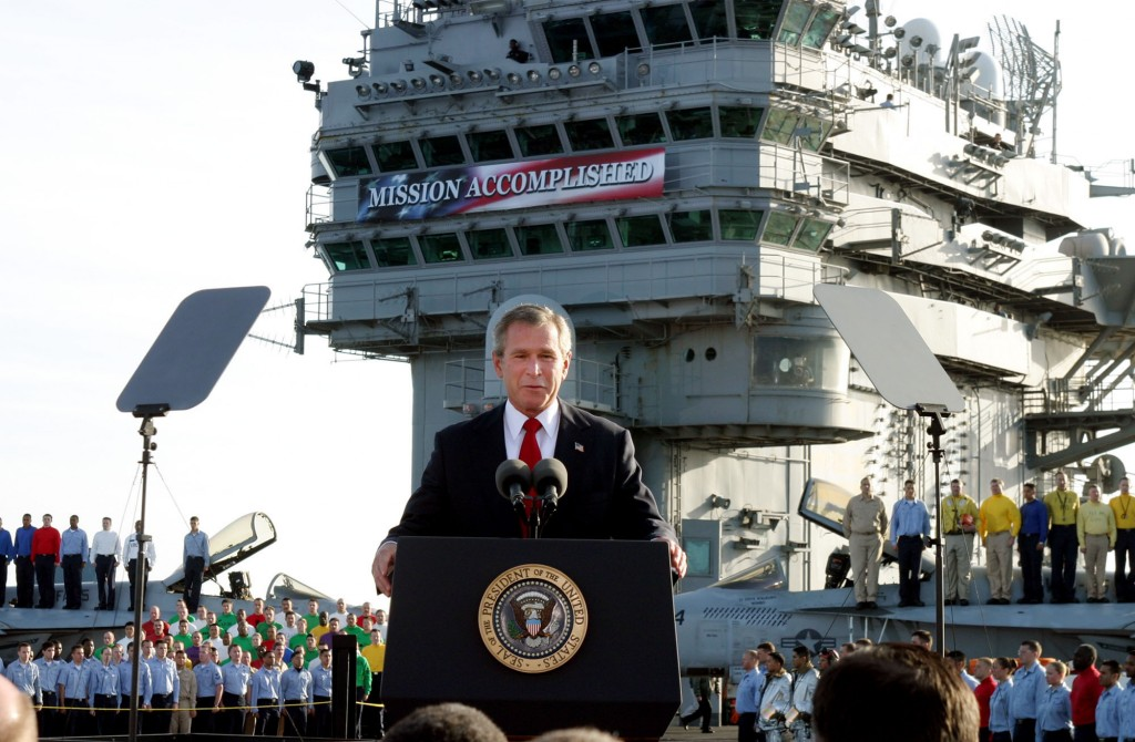 FILE - In this May 1, 2003, file photo, President George W. Bush declares the end of major combat in Iraq as he speaks aboard the aircraft carrier USS...