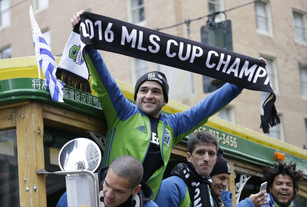 FILE - In this Dec. 13, 2016, file photo, Seattle Sounders' Nicolas Lodeiro holds a scarf during a parade after the Sounders defeated Toronto FC on De...