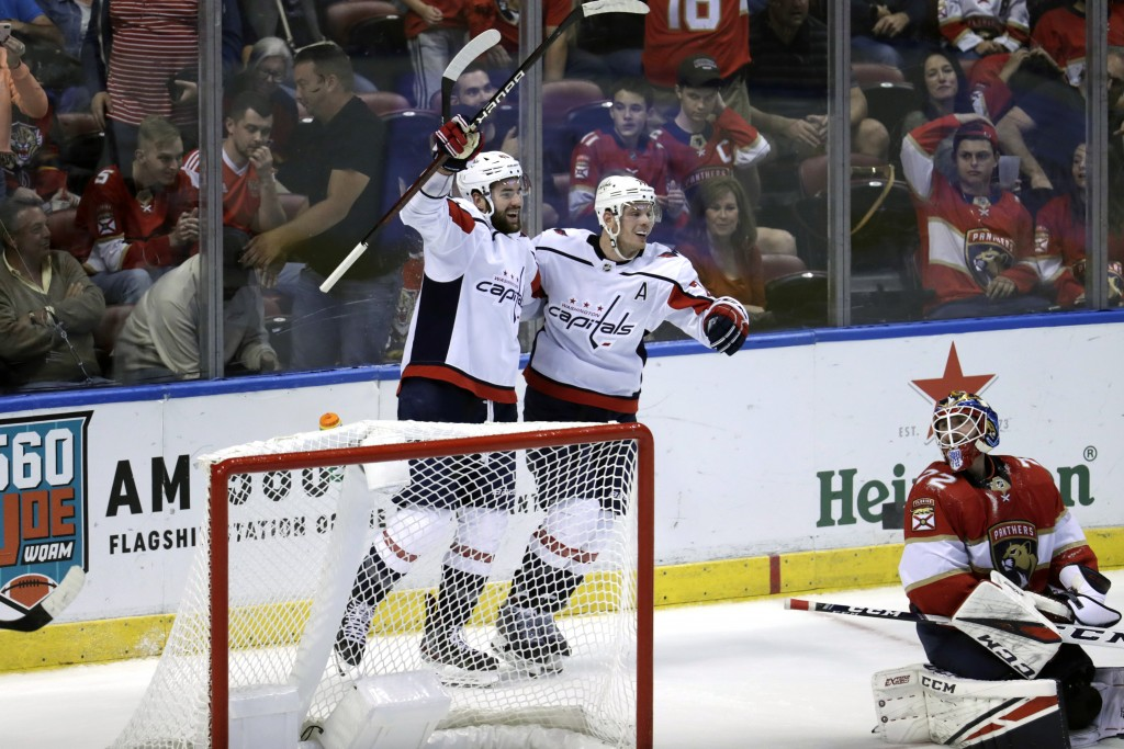 Washington Capitals right wing Tom Wilson, left, celebrates with defenseman John Carlson after scoring a goal against Florida Panthers goaltender Serg...