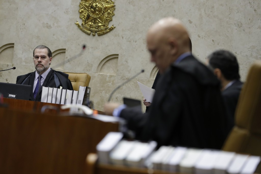 President of Brazil's Federal Supreme Court Dias Toffoli, left, opens debate on whether a defendant is to begin serving his sentence after a convictio...