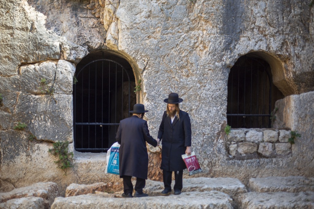 In this Thursday, Oct. 31, 2019 photo, ultra-Orthodox Jews visits the Tomb of the Kings, a large underground burial complex dating to the first centur...