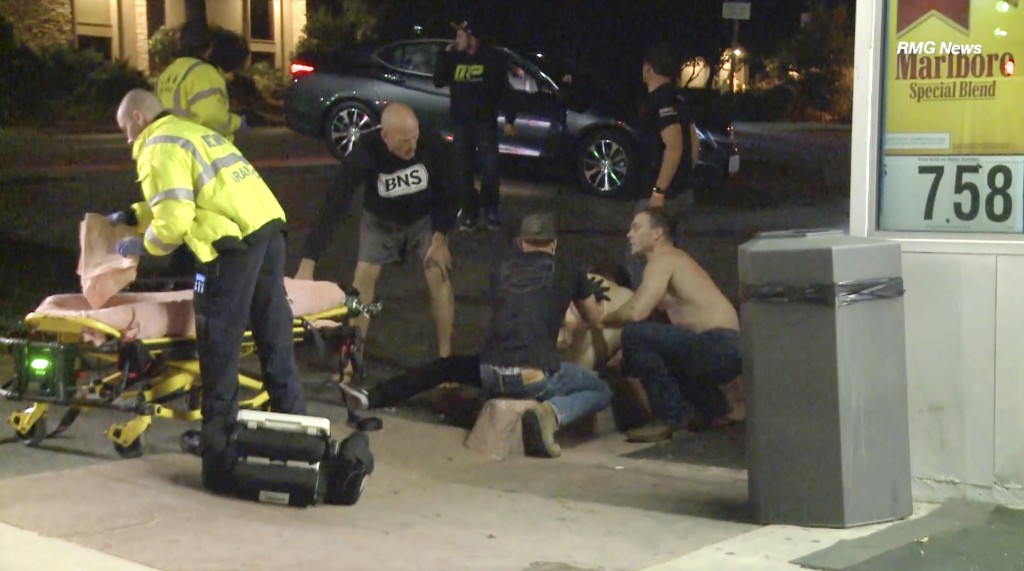FILE - In this Wednesday evening, Nov. 7, 2018 file image taken from video a victim is treated near the scene of a shooting, in Thousand Oaks, Calif. ...