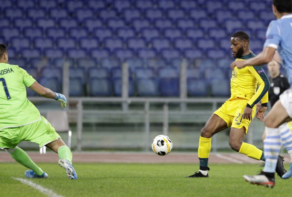 Celtic's Olivier Ntcham, right, controls to ball before scoring during an Europa League group E soccer match between Lazio and Celtic, in Rome's Olymp...