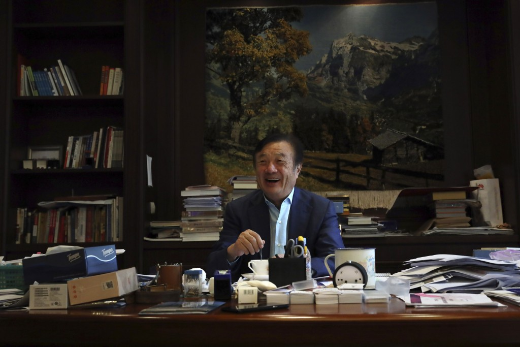 In this Aug. 20, 2019, photo, Huawei's founder Ren Zhengfei stirs his coffee as he reacts to visitors at his office on the Huawei campus in Shenzhen i...