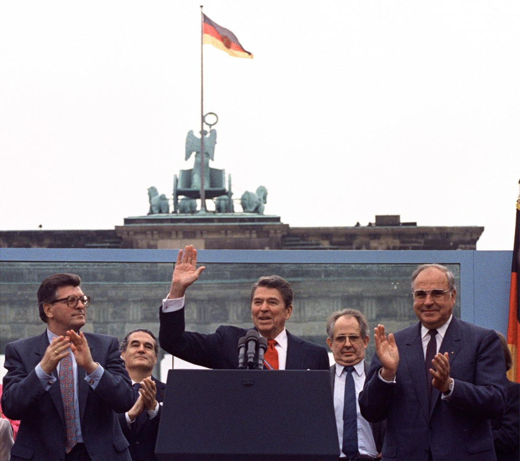 FILE - In this on Friday, June 12, 1987 file photo, U.S. President Ronald Reagan acknowledges the applause after speaking to an audience in front of t...
