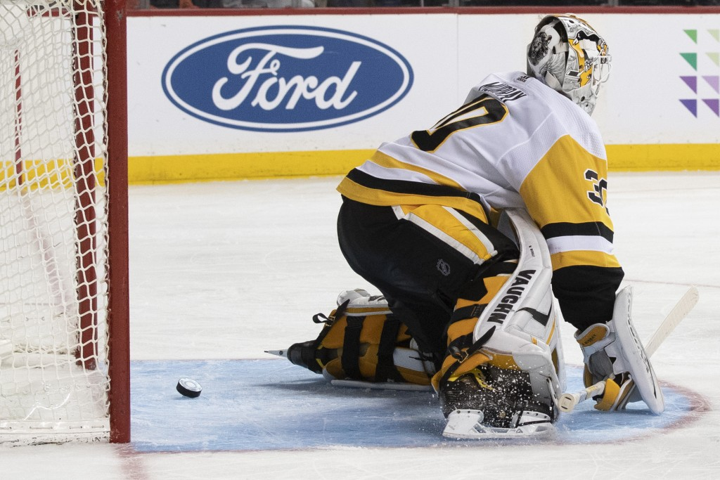 Pittsburgh Penguins goaltender Matt Murray gives up a goal to New York Islanders' Ryan Pulock during the second period of an NHL hockey game, Thursday...