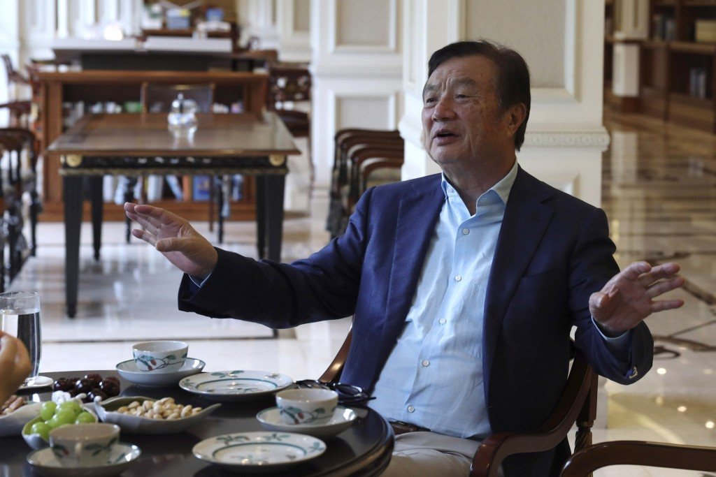 In this Aug. 20, 2019, photo, Huawei's founder Ren Zhengfei gestures as he chats with Huawei executives at the company campus in Shenzhen in Southern ...