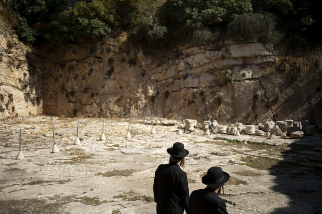 In this Thursday, Oct. 31, 2019 photo, ultra-Orthodox Jews visit the Tomb of the Kings, a large underground burial complex dating to the first century...