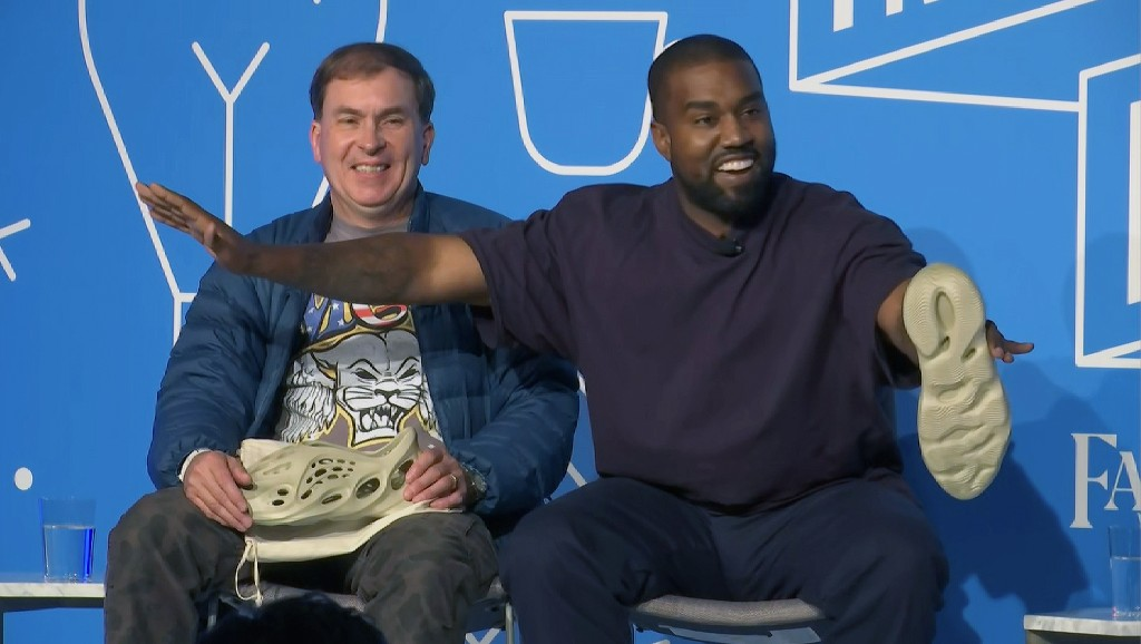 This image taken from video shows Kanye West, right, with Steven Smith, lead designer at Yeezy during a discussion on fashion and design at the Fast C...
