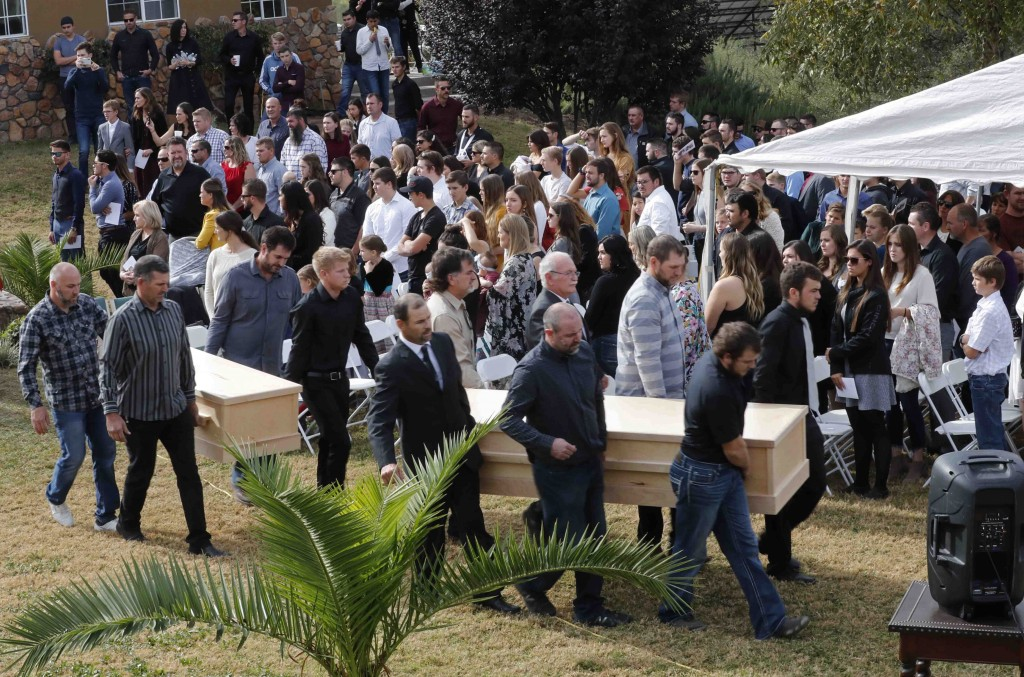 Men carry the remains of Dawna Ray Langford, 43, and her sons Trevor, 11, and Rogan, 2, who were killed by drug cartel gunmen, before they are buried ...