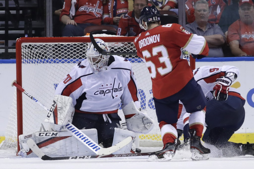 Florida Panthers right wing Evgenii Dadonov (63) scores a goal against Washington Capitals goaltender Braden Holtby (70) during the second period of a...