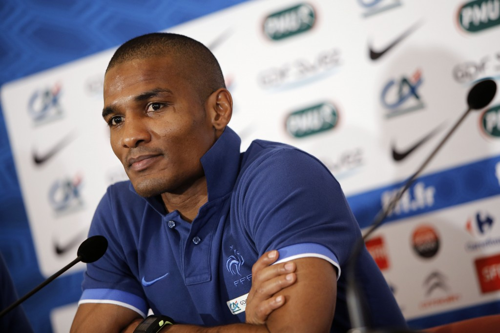 FILE - In this Wednesday, June 20, 2012 file photo, France's Florent Malouda attends a press conference prior to a Euro 2012 soccer quarterfinal match...