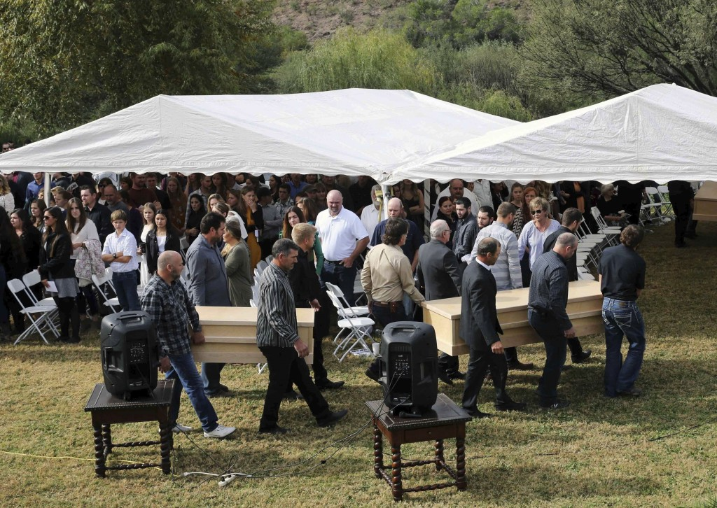 Men carry the remains of Dawna Ray Langford, 43, and her sons Trevor, 11, and Rogan, 2, who were killed by drug cartel gunmen, before their burial at ...