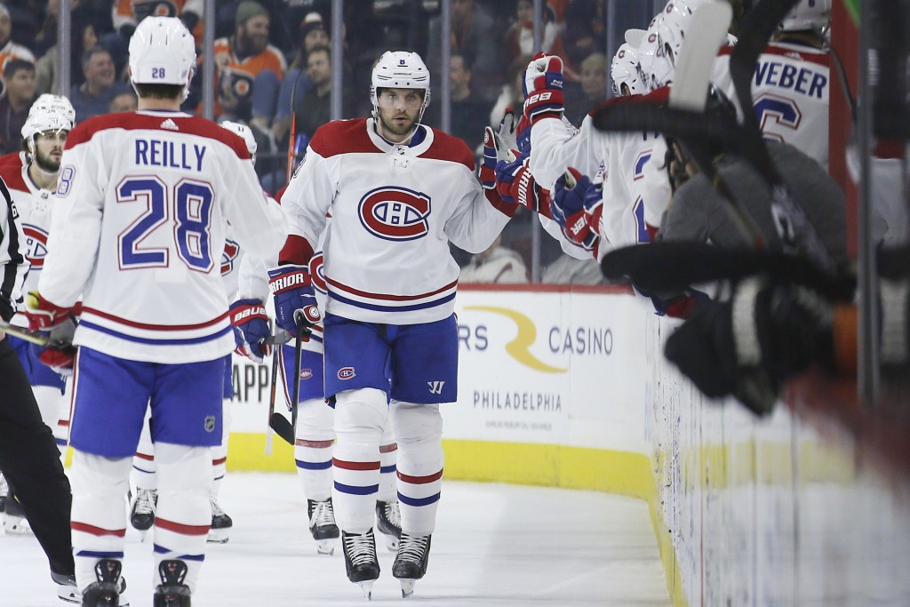 Montreal Canadiens' Ben Chiarot celebrates with teammates after scoring a goal during the second period of an NHL hockey game against the Philadelphia...
