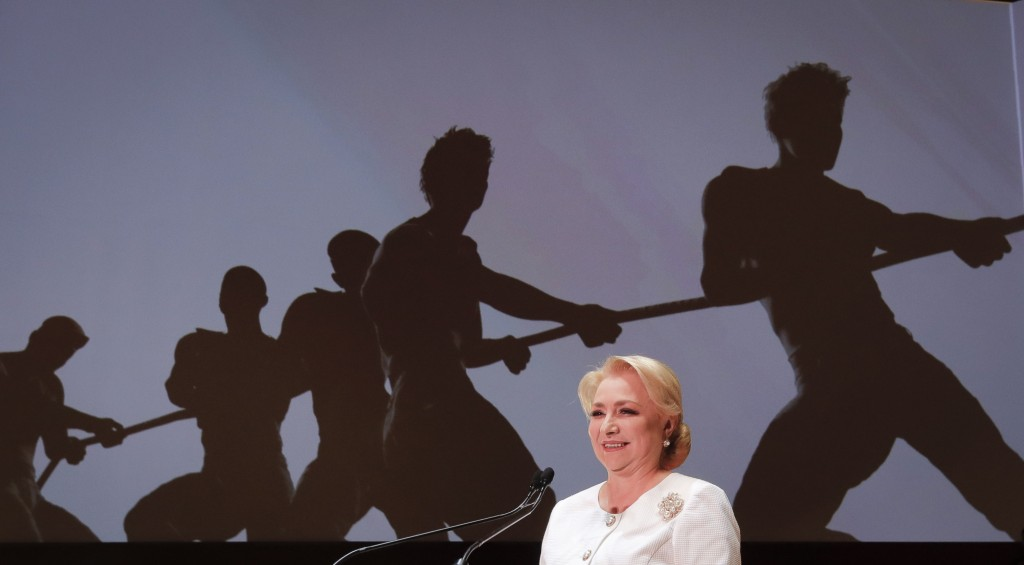 FILE - In this Saturday, Aug. 24, 2019, file picture Romanian Prime Minister Viorica Dancila smiles during a congress of the ruling Social Democratic ...