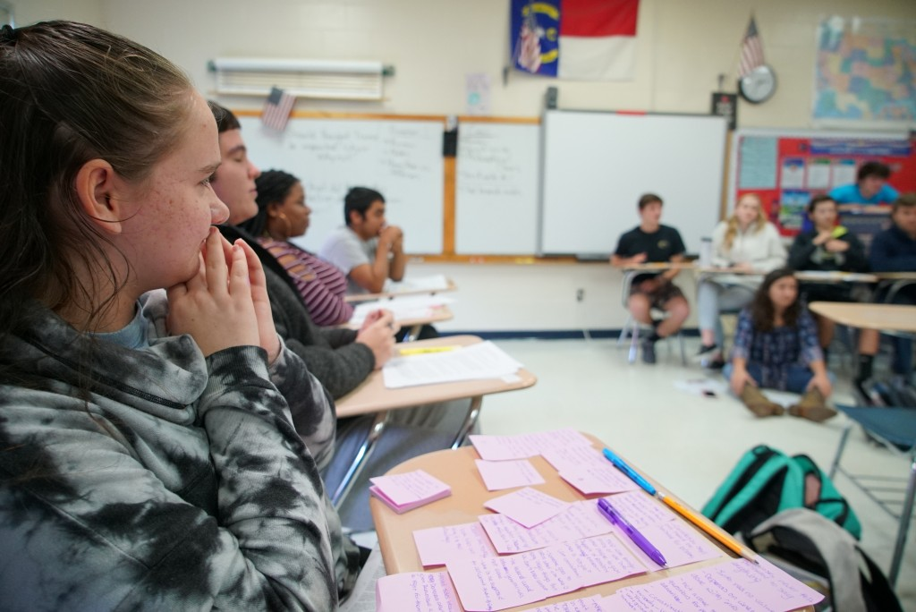 Kaylee Maness listens to arguments during civics class at Chatham Central High School in Bear Creek, N.C., on Tuesday, Nov. 5, 2019. The 10th-grader h...