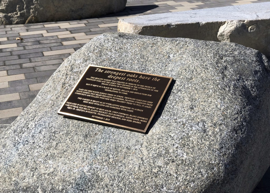 This October 2019 photo shows a plaque on one of several boulders at The Healing Garden, a public park memorial to commemorate the 12 people killed in...