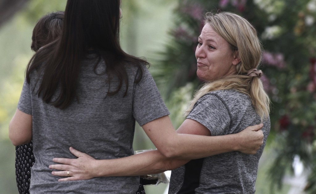 Women embrace during the funeral of Dawna Ray Langford, 43, and her sons Trevor, 11, and Rogan, 2, who were killed by drug cartel gunmen, at the cemet...