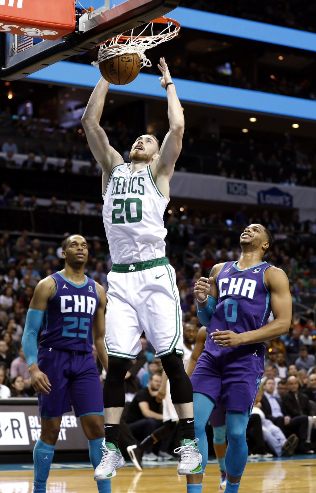 Boston Celtics' Gordon Hayward (20) dunks as Charlotte Hornets' P.J. Washington (25) and Miles Bridges (0) watch during the first half of an NBA baske...