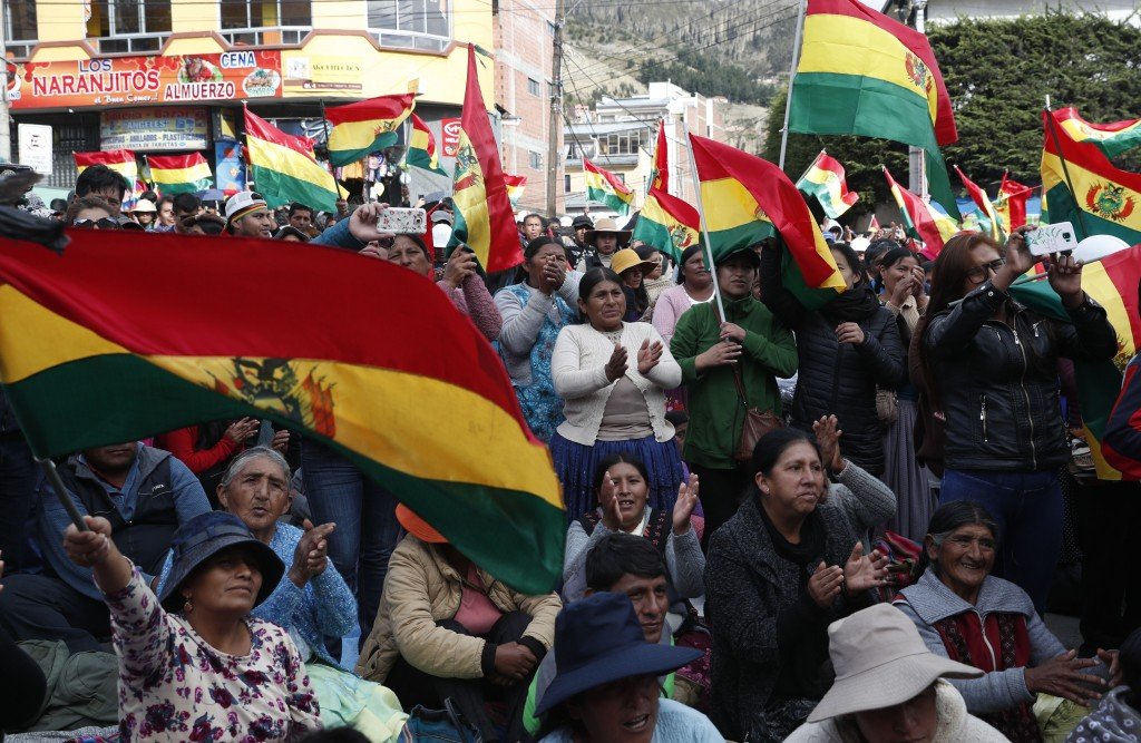Anti-government protesters against the reelection of President Evo Morales, attend a rally with the coca leaf growers in La Paz, Bolivia, Thursday, No...