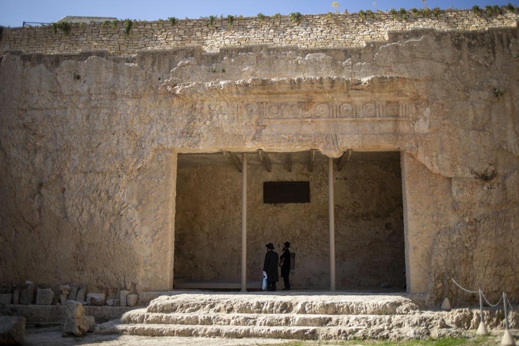 In this Thursday, Oct. 31, 2019 photo, ultra-Orthodox Jews pray in the Tomb of the Kings, a large underground burial complex dating to the first centu...