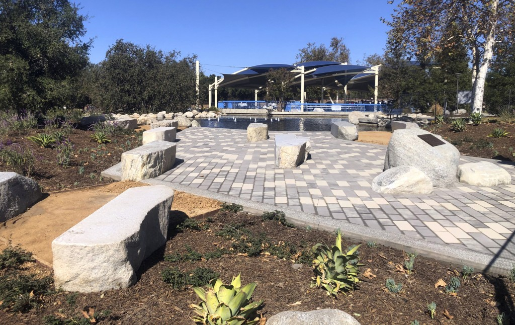 This October 2019 photo provided by Andrew Mooney shows The Healing Garden, a public park memorial to commemorate the 12 people killed in a mass shoot...