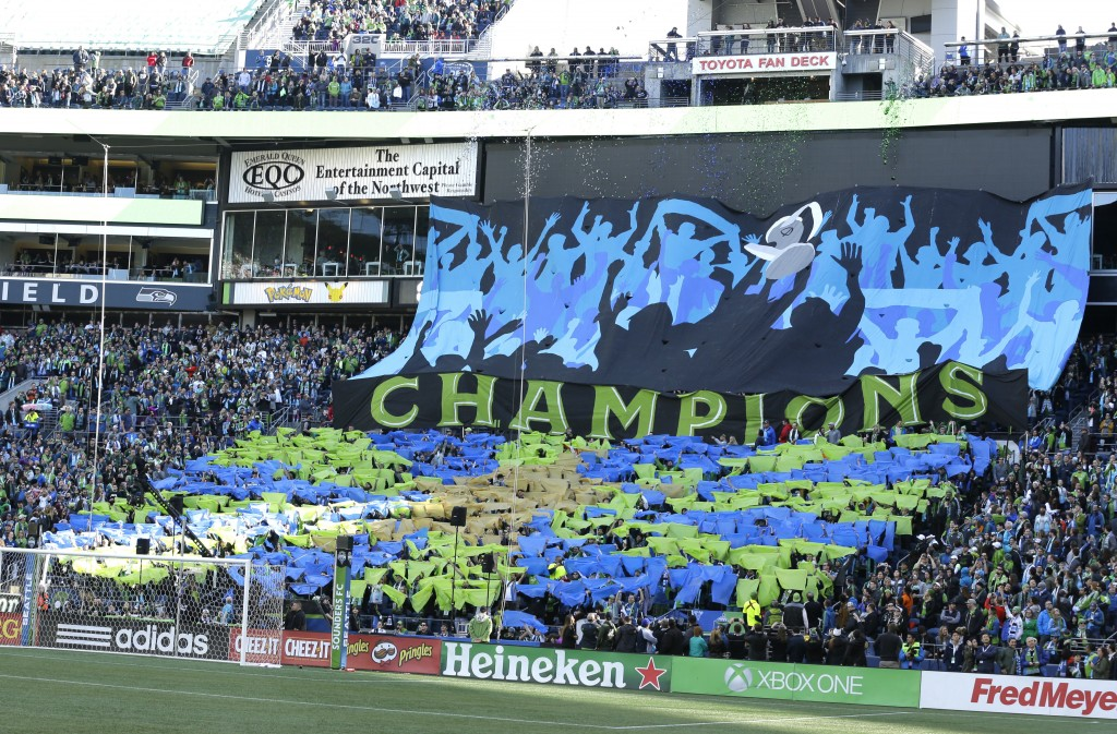"FILE - In this March 19, 2017, file photo, Seattle Sounders supporters display a tifo that reads ""Champions"" at the start of the Sounders home opener ..."