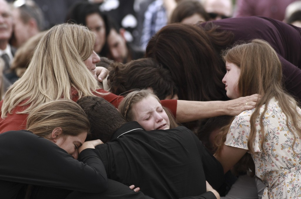 Family and friends weep during the funeral service for Dawna Ray Langford, 43, and her sons Trevor, 11, and Rogan, 2, who were killed in an ambush ear...