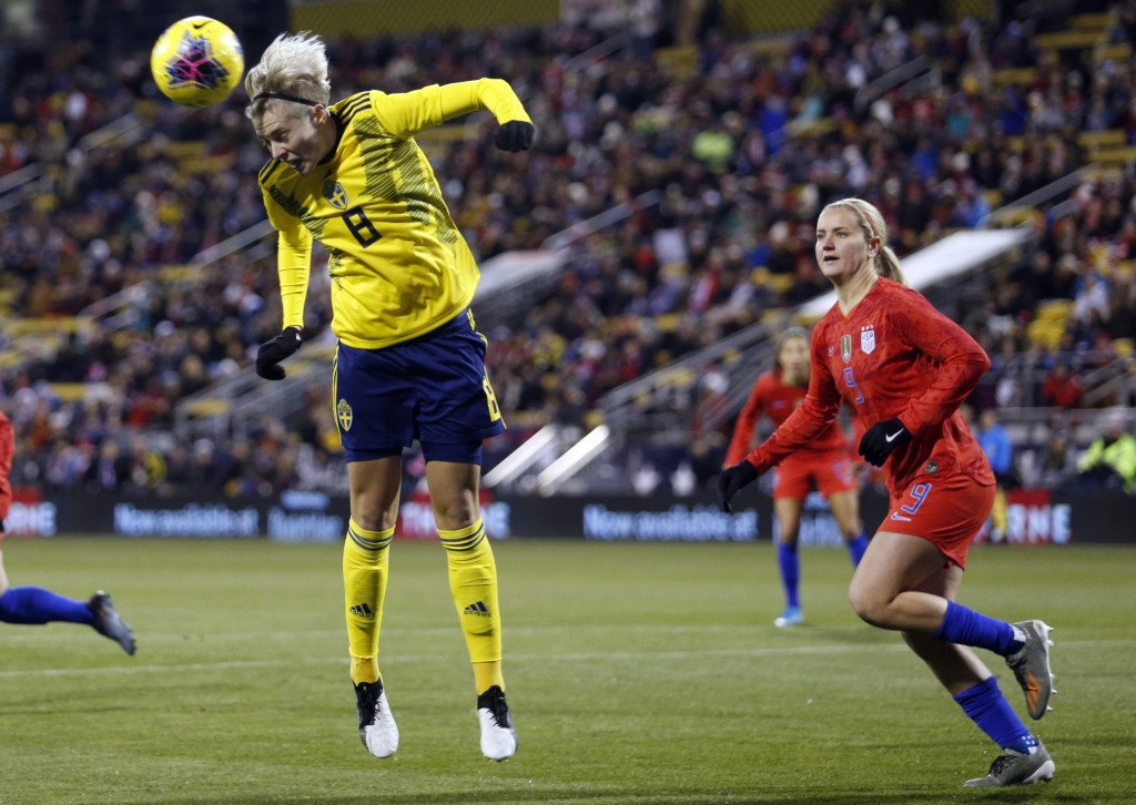 Sweden forward Lina Hurtig, left, heads the ball away from United States midfielder Lindsey Horan during the first half of a women's international fri...