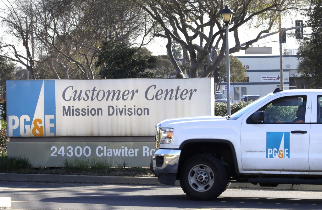 FILE- In this Jan. 23, 2019, file photo a Pacific Gas & Electric truck enters their customer center in Hayward, Calif. Pacific Gas & Electric Co. on T...