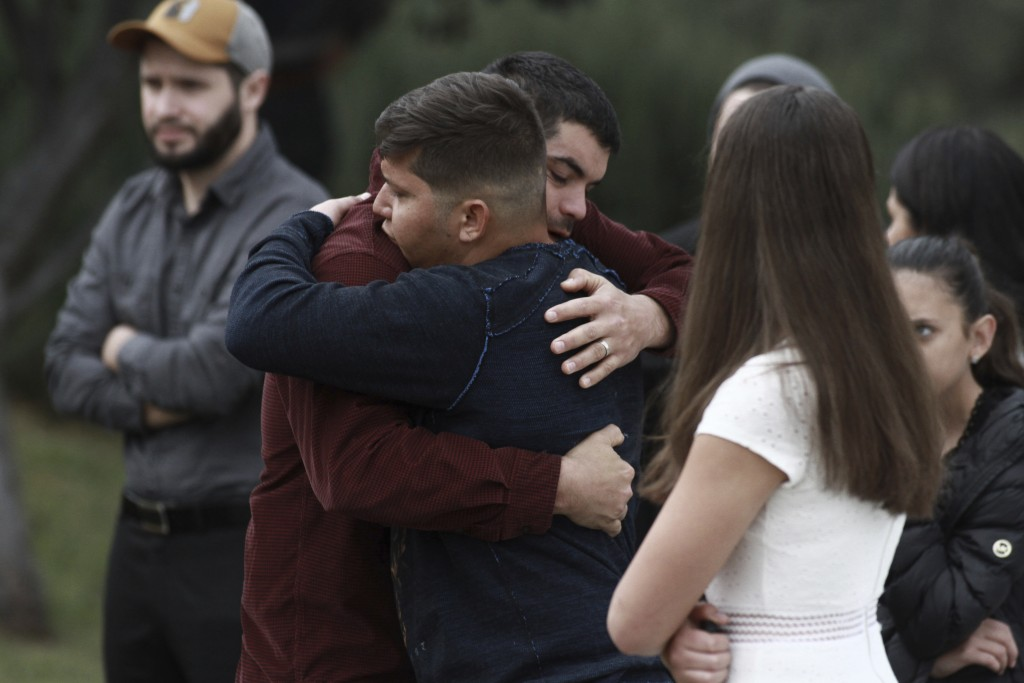 People attend the funeral of Dawna Ray Langford, 43, and her sons Trevor, 11, and Rogan, 2, who were killed by drug cartel gunmen, at the cemetery in ...