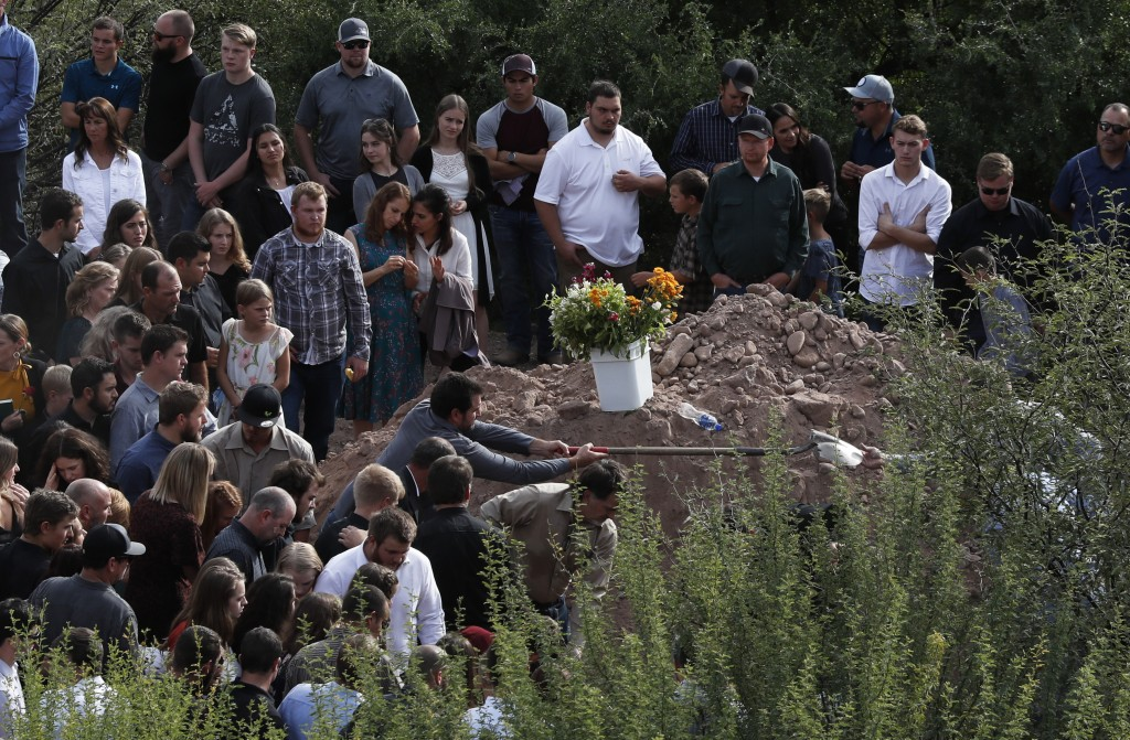 Family and friends gather for the burial service for Dawna Ray Langford, 43, and her sons Trevor, 11, and Rogan, 2, who were killed in an ambush earli...