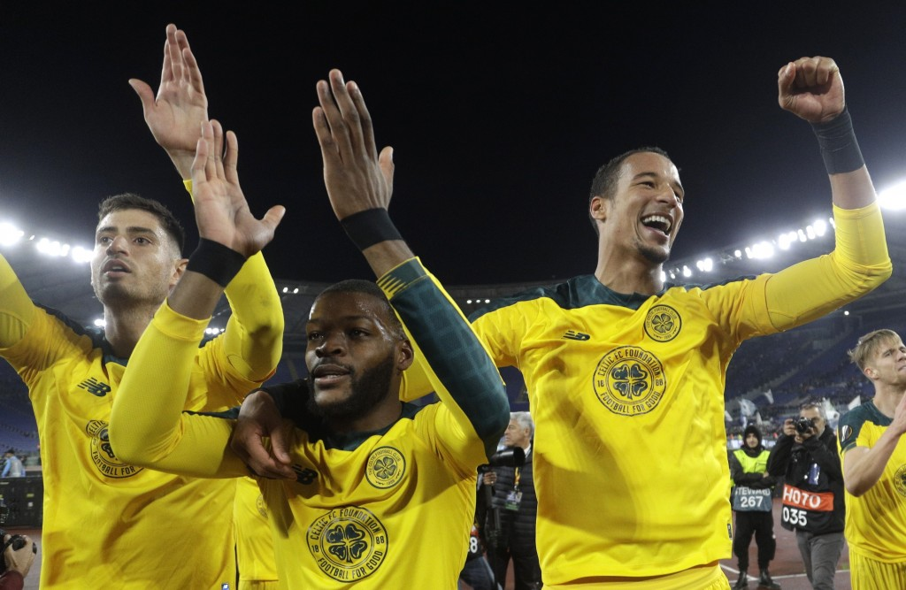 Celtic's Olivier Ntcham, center, celebrates with teammate after scoring his side's winning goal during an Europa League group E soccer match between L...