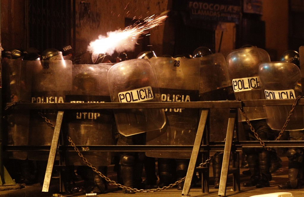 Police fire tear gas at demonstrators during a protest against the reelection of President Evo Morales, in La Paz, Bolivia, Thursday, Nov. 7, 2019. Th...